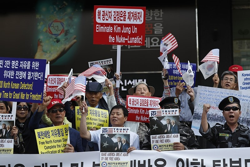 North Korean defectors and activists shout slogans during a rally against North Korea's sixth nuclear test, in downtown in Seoul, South Korea, 08 September 2017. (EPA Photo)