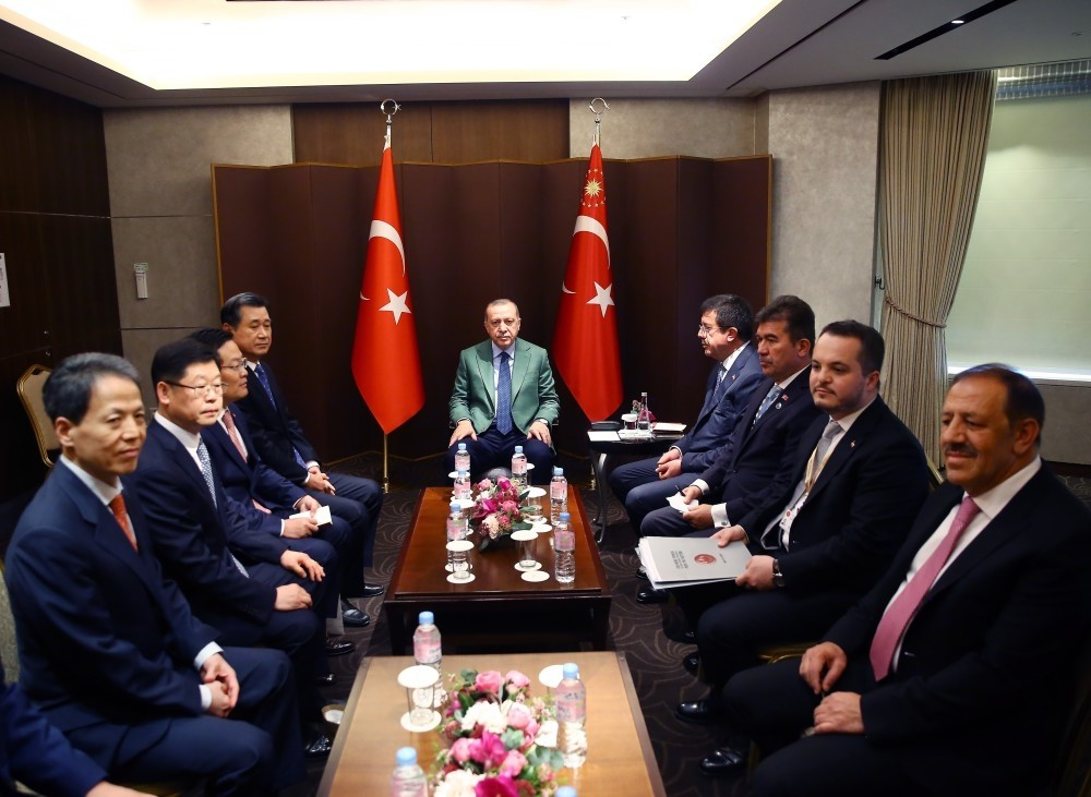 President Erdou011fan (C) met the executives of South Korean Hanwha Q-cellls during his two-day visit in the country, Seoul, May 3.