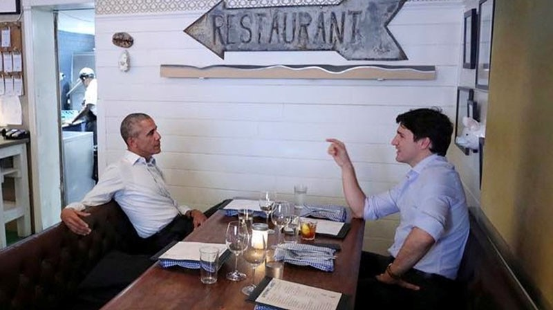 Canada's Prime Minister Justin Trudeau speaks with former United States President Barack Obama at a restaurant during Obama's visit to address the Montreal Chamber of Commerce, in Montreal, Quebec, Canada June 6, 2017 (Reuters Photo)