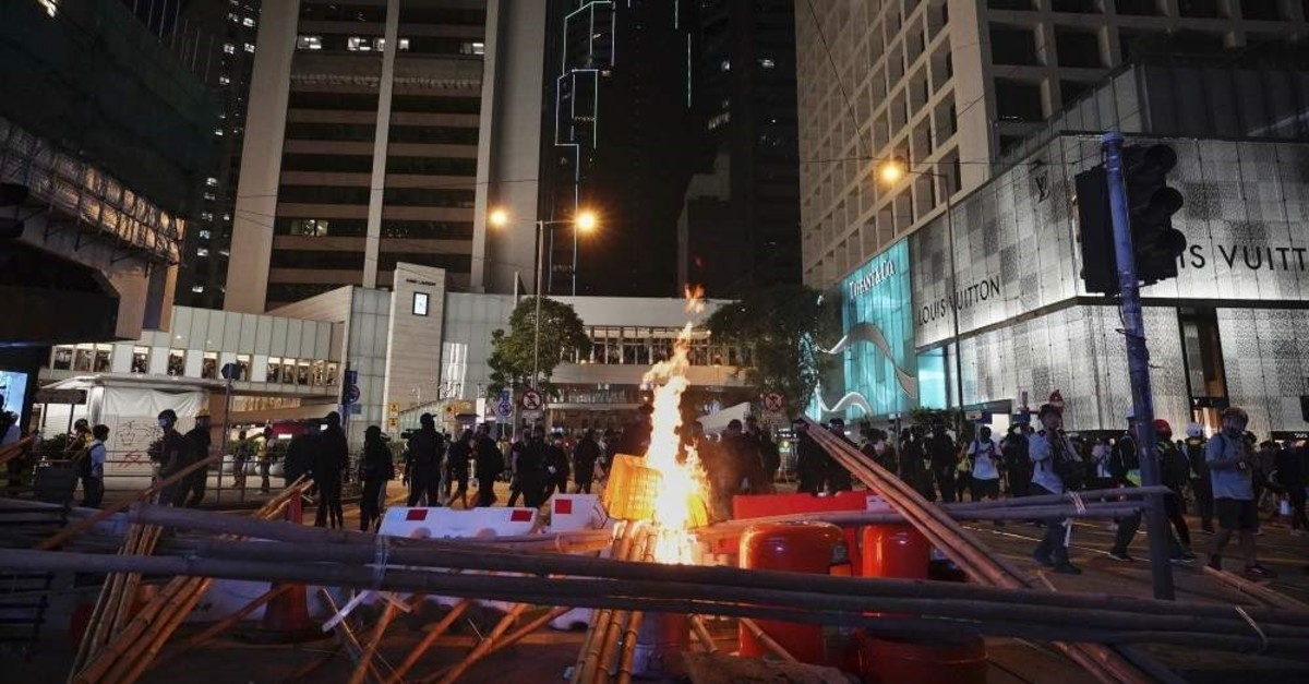 Demonstrators gather near a burning barricade in the street during a protest, Hong Kong, Nov. 2, 2019. (AP Photo)