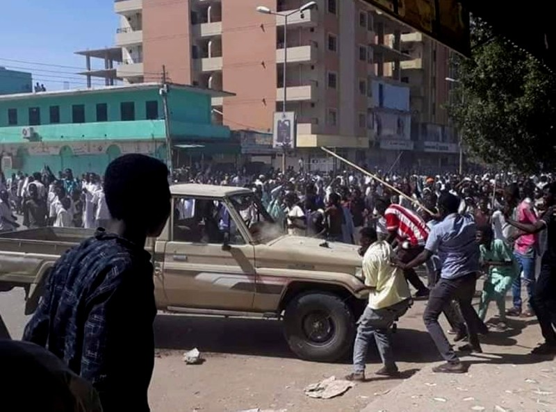 In this Sunday, Dec. 23, 2018 handout photo provided a Sudanese activist, people chant slogans and attack a national security vehicle during a protest, in Kordofan, Sudan. (AP Photo)