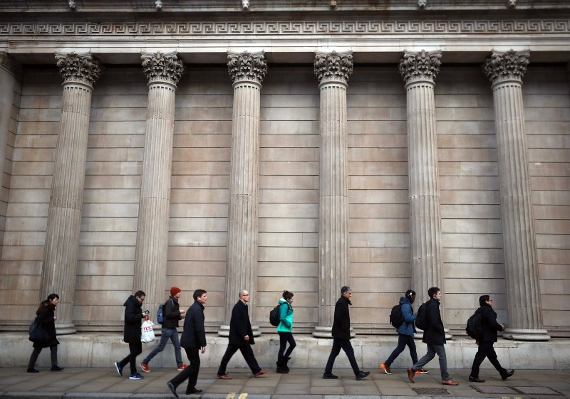 Commuters walk past the Bank of England in the City of London, Britain, Feb. 7, 2019. (Reuters Photo)