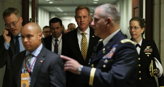 Acting U.S. Defense Secretary Patrick Shanahan (C) arrives at a closed briefing for Senate members May 21, 2019 on Capitol Hill in Washington, D.C. (AFP Photo)