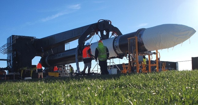 The electron rocket being transported to a launch pad prior to liftoff at the Rocket Lab Launch Complex 1 on the Mahia Peninsula, North Island, New Zealand.