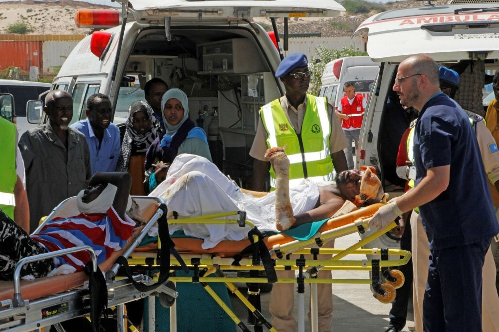 Turkish doctors transport a critically wounded man on a stretcher to a waiting Turkish air ambulance, Mogadishu, Somalia, Oct. 16.
