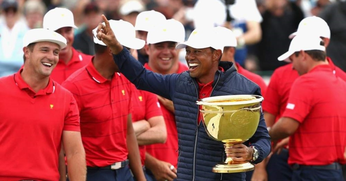 Tiger Woods celebrating after the U.S. team won the President's Cup golf tournament in Melbourne, Dec. 15, 2019. (AP Photo)