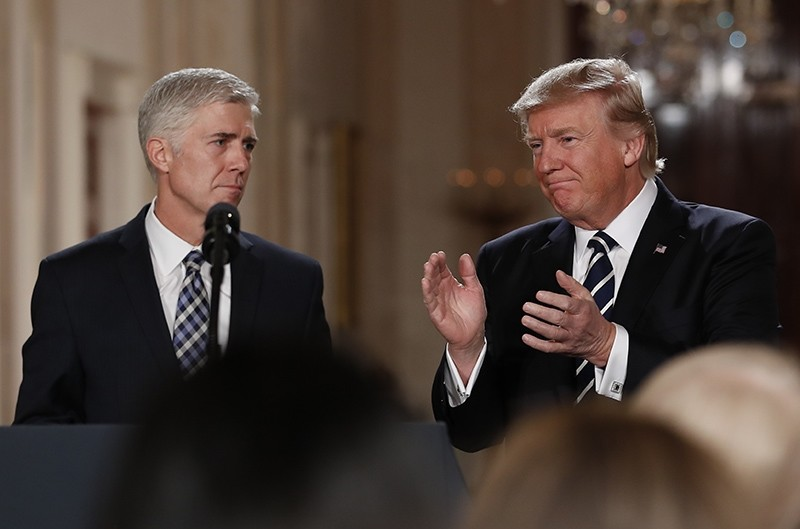 President Donald Trump applauds as he stands with Judge Neil Gorsuch in East Room of the White House in Washington, Tuesday, Jan. 31, 2017 (AP Photo)