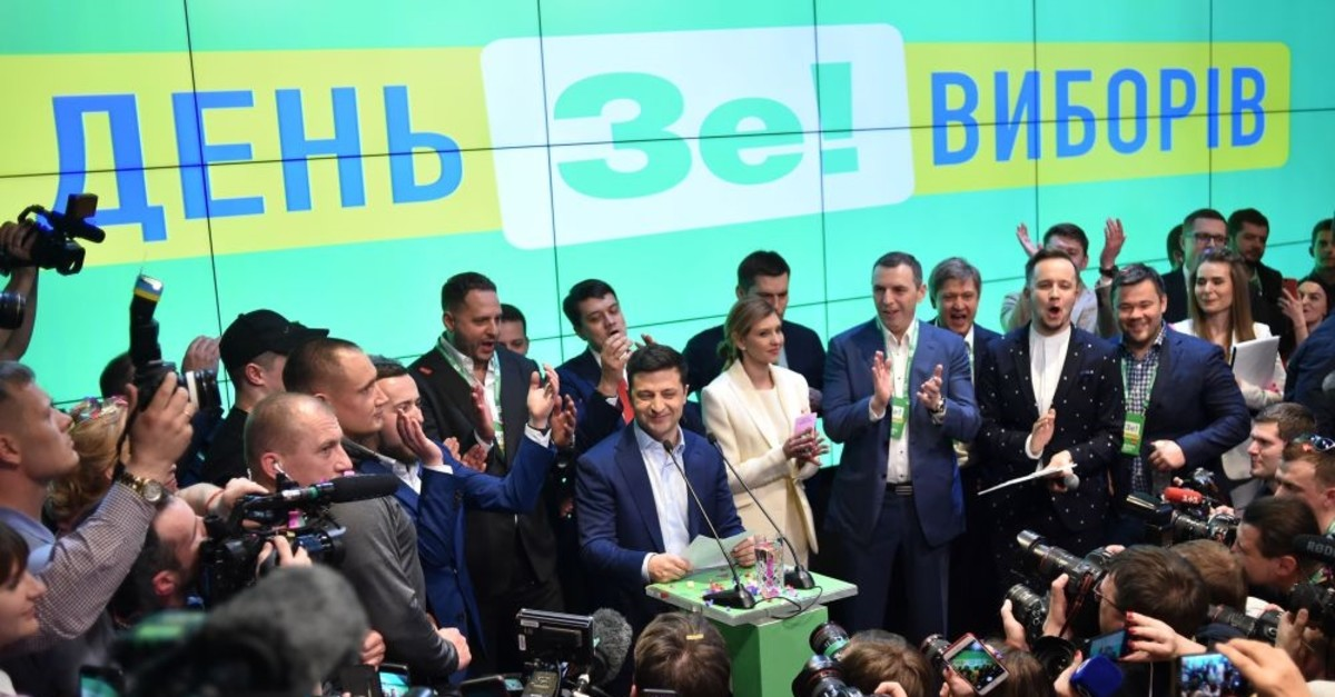 Ukrainian comedian and presidential candidate Volodymyr Zelensky gives a speech after the announcement of the first exit poll results in the second round of Ukraine's presidential election at his campaign headquarters in Kiev, April 21, 2019.