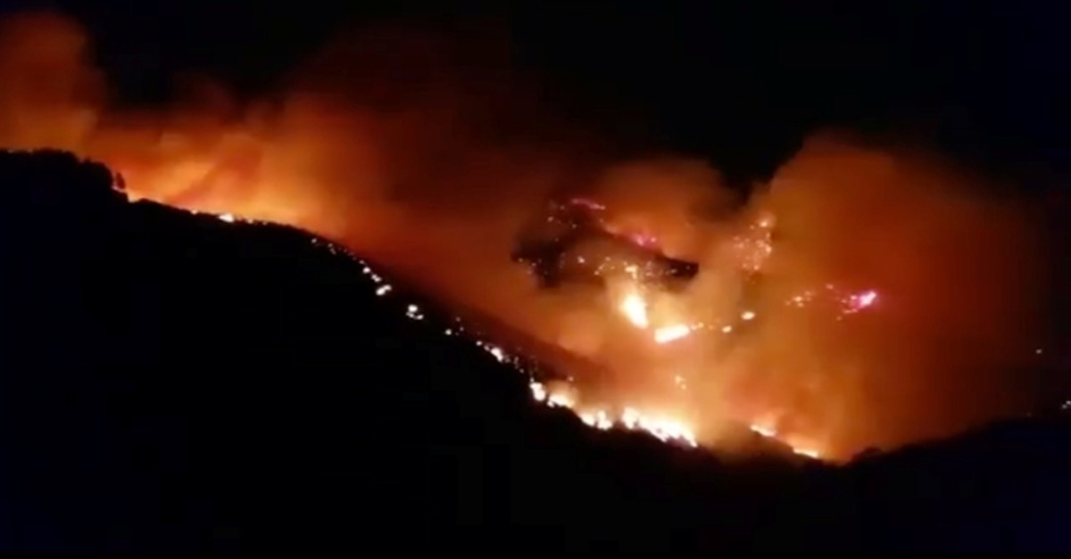 A wildfire burns in this still image obtained from social media video between Juncalillo and Pinos de Galdar, on Gran Canaria, Canary Islands, Spain in the early hours of August 11, 2019. (Reuters Photo)