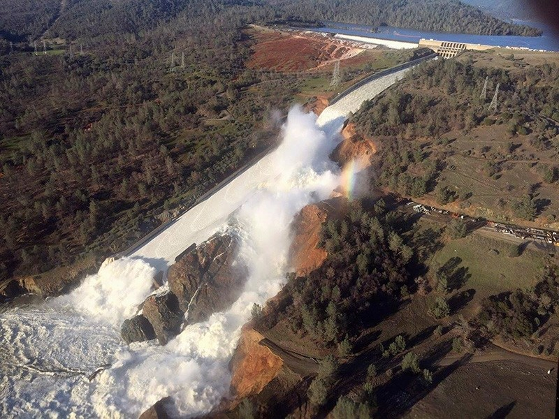 A damaged spillway with eroded hillside is seen in an aerial photo taken over the Oroville Dam in Oroville, California, U.S. February 11, 2017.(California Department of Water Resources / William Croyle via Reuters)