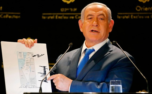 Israeli Prime Minister Benjamin Netanyahu displays a map of Israel indicating the Golan Heights are inside the state's borders, signed by US president Donald Trump and handed over to him by Jared Kushner AFP Photo