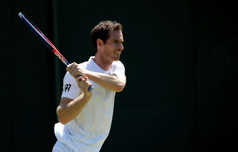 Andy Murray practices on a practice court Saturday June 30, 2018, ahead of the start of the 2018 Wimbledon Championships in Wimbledon, London. (PA via AP)