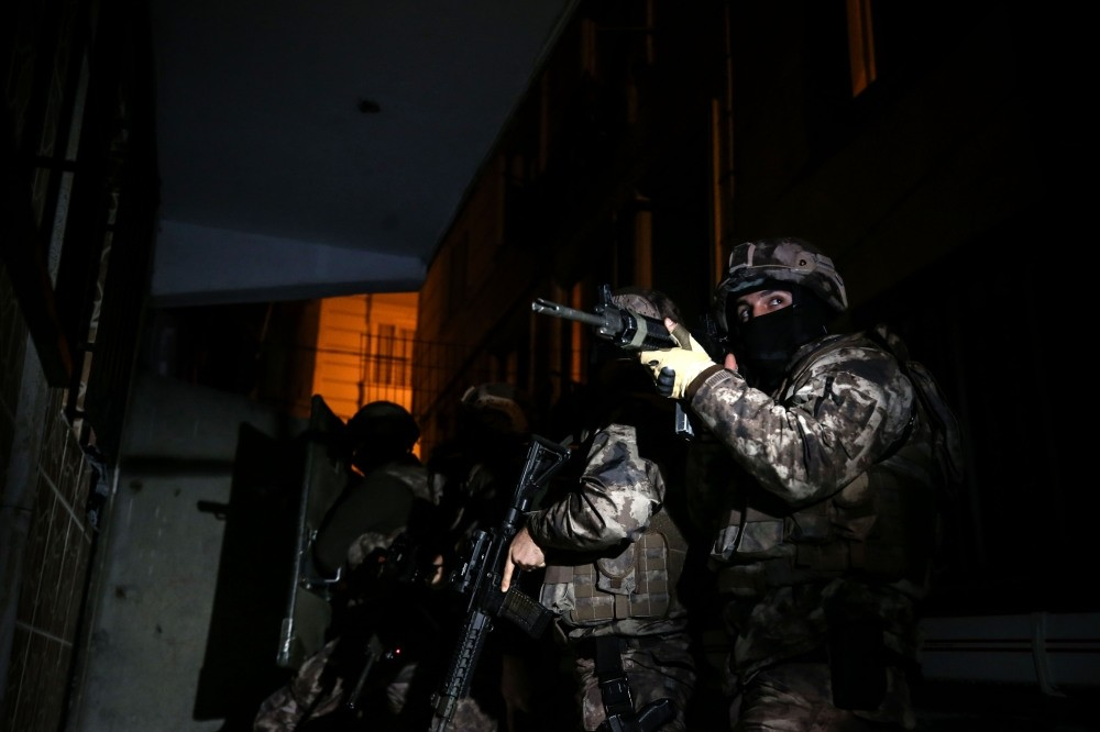 Special Operations police storm a house during yesterday's operations.