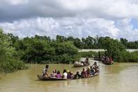 Beim Untergang eines Bootes mit Rohingya-Flüchtlingen aus Myanmar sind vor der Südküste von Bangladesch mindestens zwölf Menschen ertrunken.  Helfer bargen die Leichen von zehn Kindern, einer...