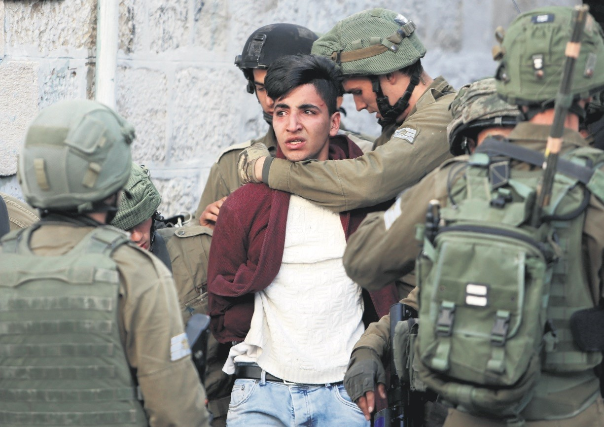 Israeli soldiers detain a Palestinian during a protest against U.S. President Trump's decision to recognize Jerusalem as the capital of Israel, Hebron West Bank, Dec. 10.