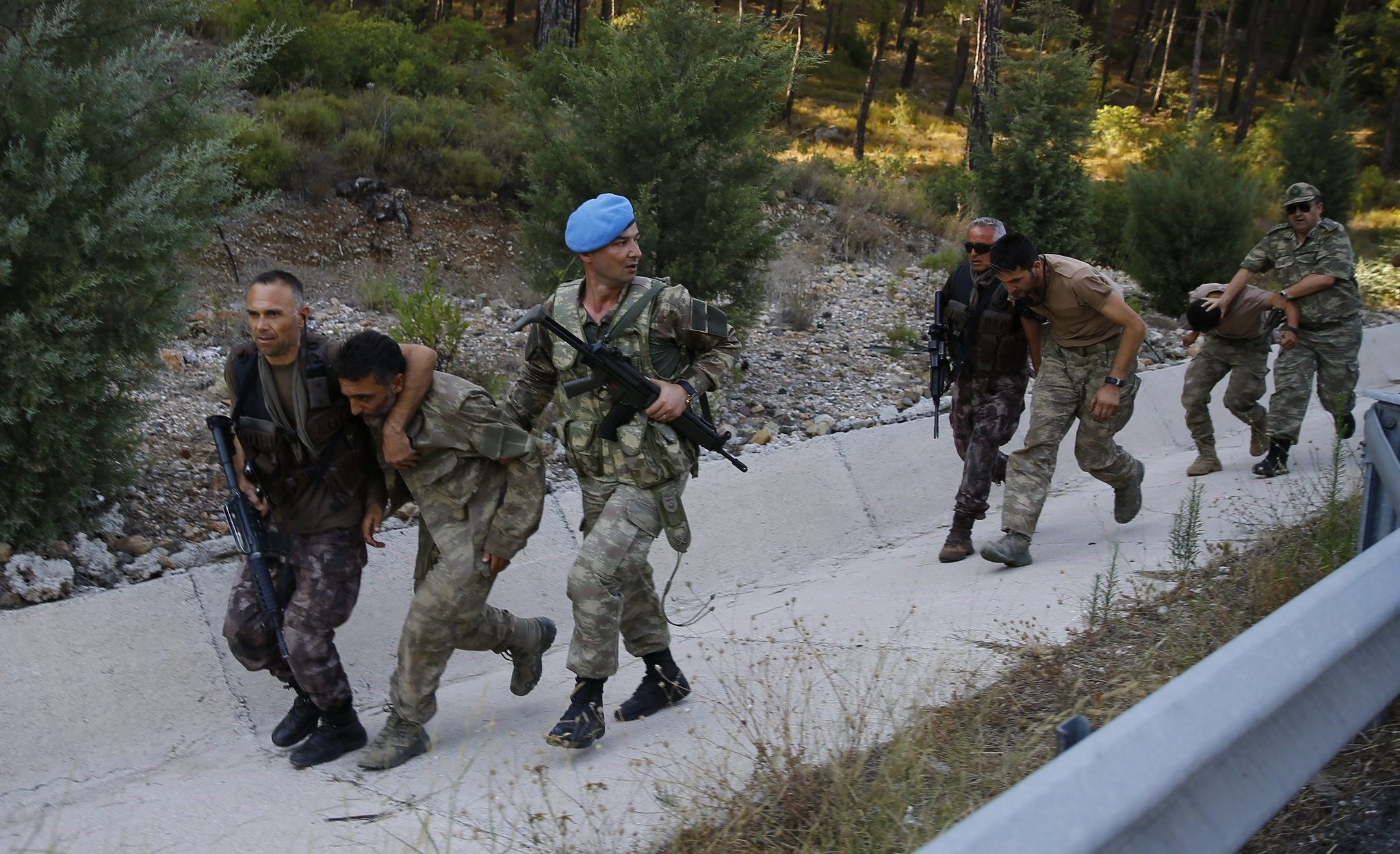 Security forces accompany pro-coup troops captured days after they went into hiding in a forest, after their plot to kill Erdou011fan was foiled.