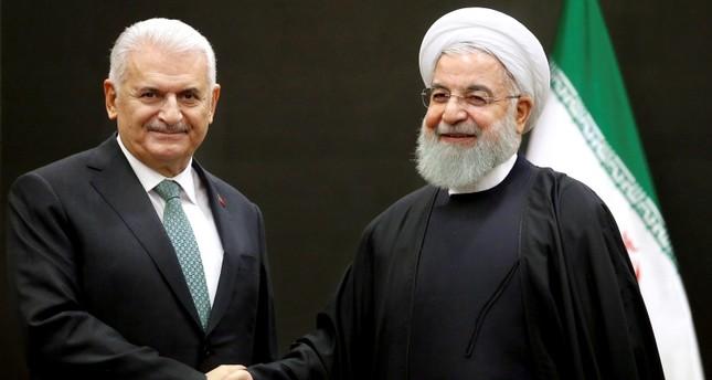يلدريم يلتقي الرئيس الإيراني في طهران