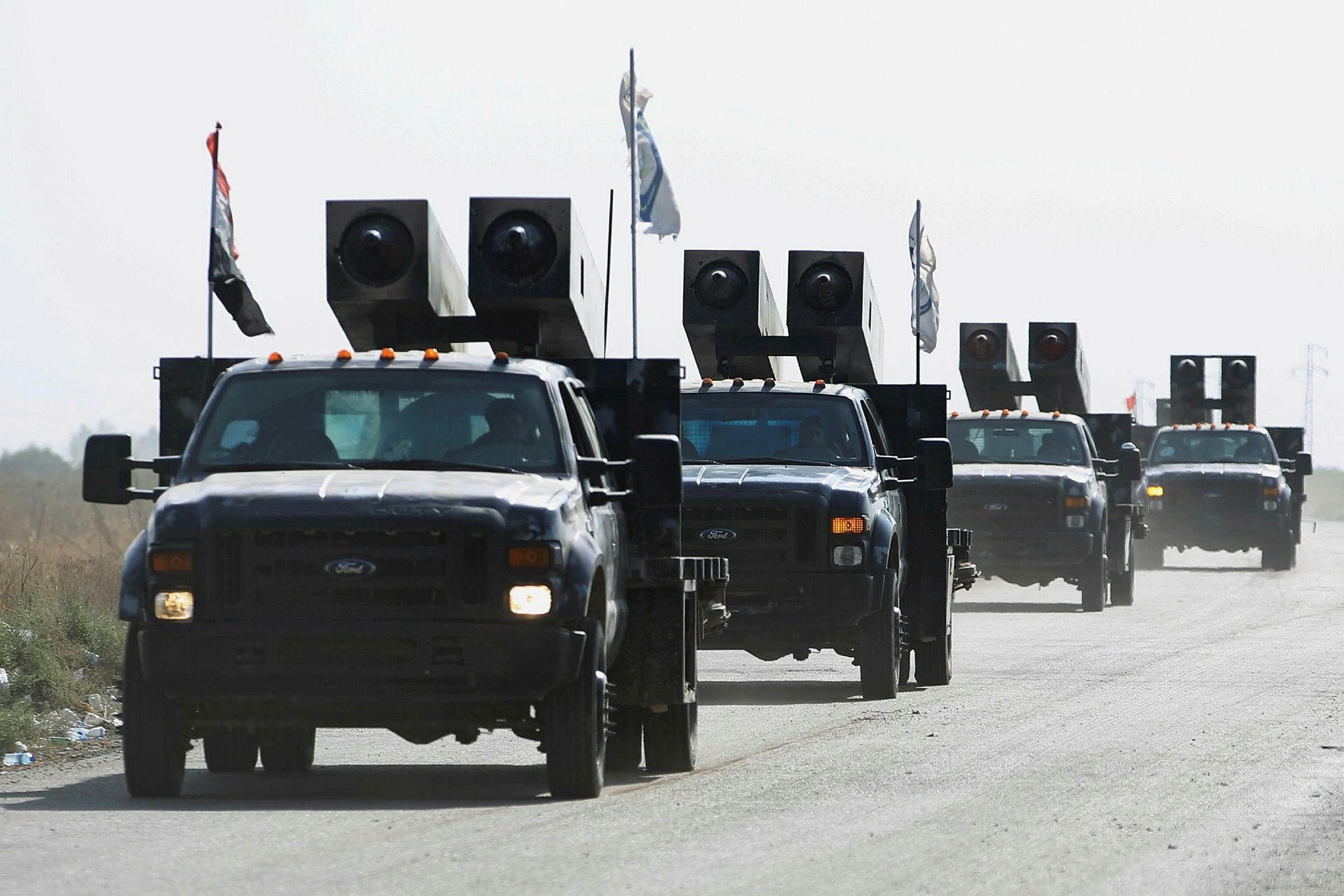 Iraqi forces drive toward Kurdish peshmerga positions on the southern outskirts of Kirkuk, Oct. 14.