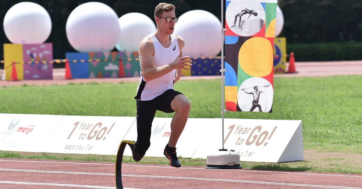 Germanyu2019s Paralympic athlete Markus Rehm warms up in a long jump demonstration in Tokyo on Aug. 25, 2019, as part of a countdown event marking one year before the start of the Tokyo 2020 Paralympic Games.