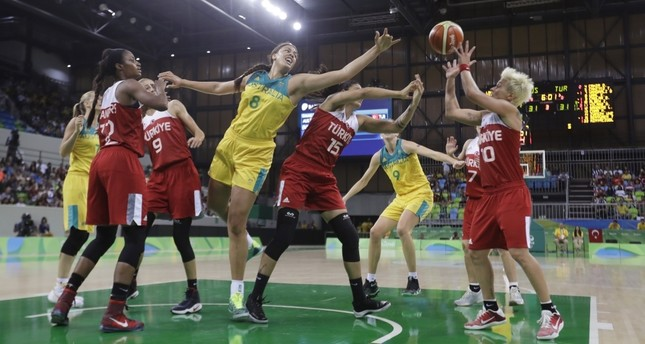 Australia center Liz Cambage (8), Turkey forward Tilbe Şenyürek (15) and Işıl Alben reach for the rebound during the second half of a women's basketball game at the Youth Center at the 2016 Summer Olympics in Rio de Janeiro.