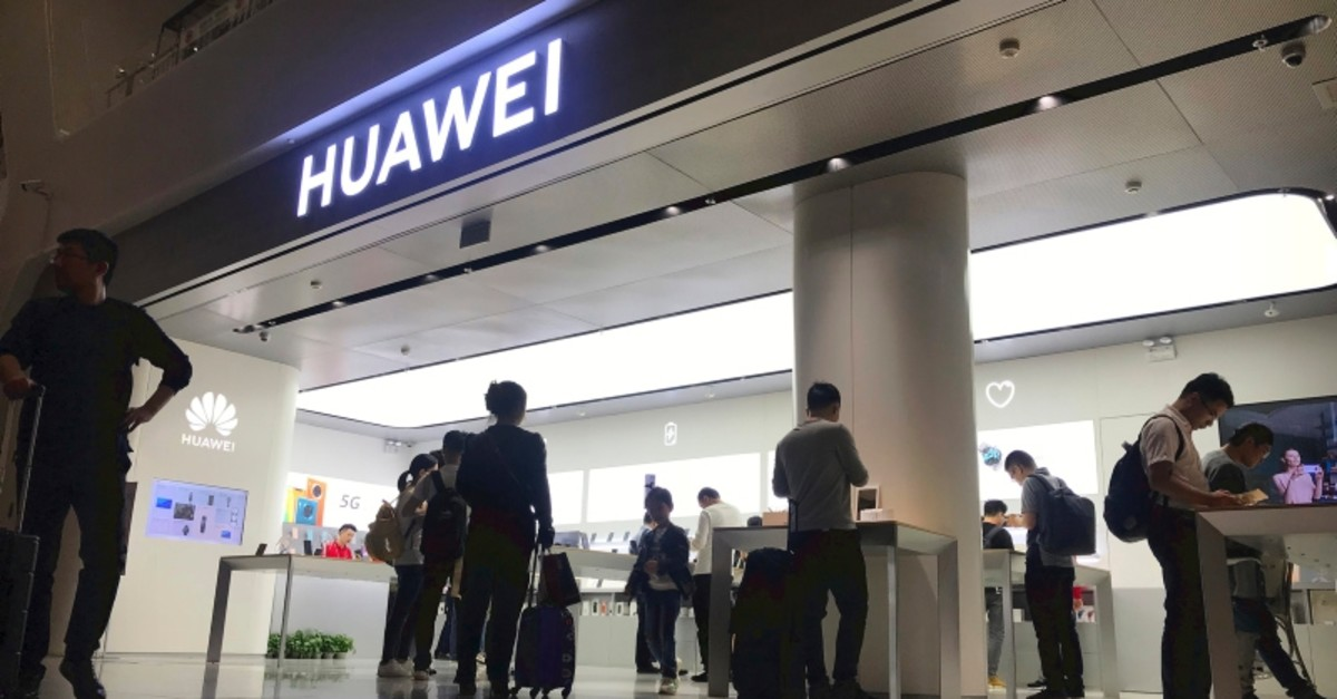 People look at a Huawei store in Shenzhen Bao'an International Airport in Shenzhen in southern China's Guangdong Province, Friday, Nov. 15, 2019. (AP Photo)