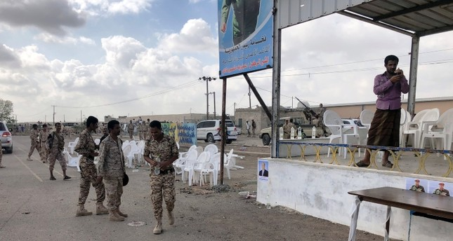 Soldiers inspect the scene of a Houthi drone attack at Yemeni government military parade in al-Anad air base, Lahaj province, Yemen, Jan. 10, 2019. (Reuters Photo)