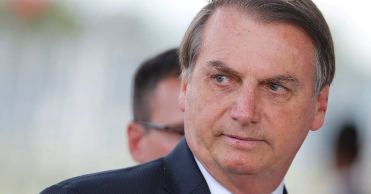 Brazil's President Jair Bolsonaro looks on as he leaves the Alvorada Palace in Brasilia, Brazil, Dec. 12, 2019. (REUTERS/Adriano Machado/File Photo)