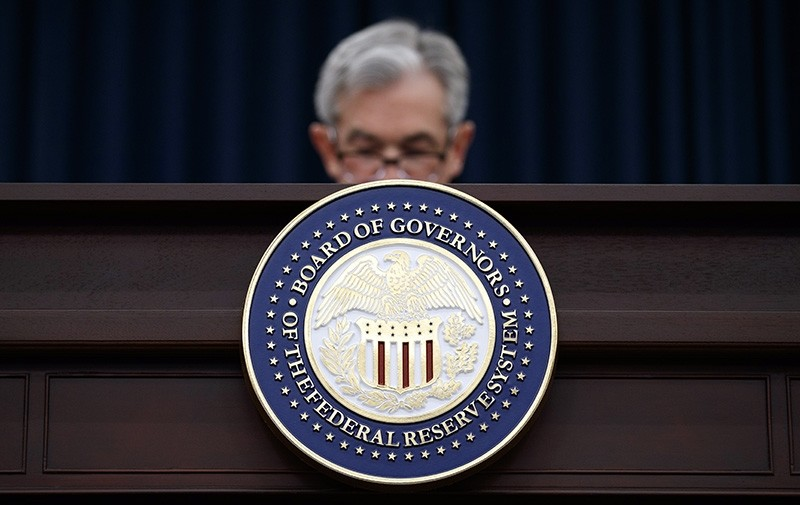 In this March 21, 2018, file photo Federal Reserve Chairman Jerome Powell looks to his notes as he speaks during a news conference following the Federal Open Market Committee meeting in Washington. (AP Photo)