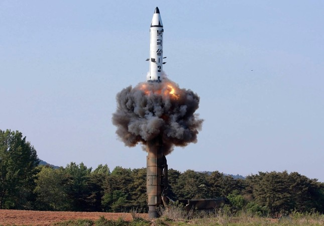 In this undated file photo distributed by the North Korean government on May 22, 2017, a solid-fuel Pukguksong-2 missile lifts off during its launch test at an undisclosed location in North Korea. (AP Photo)