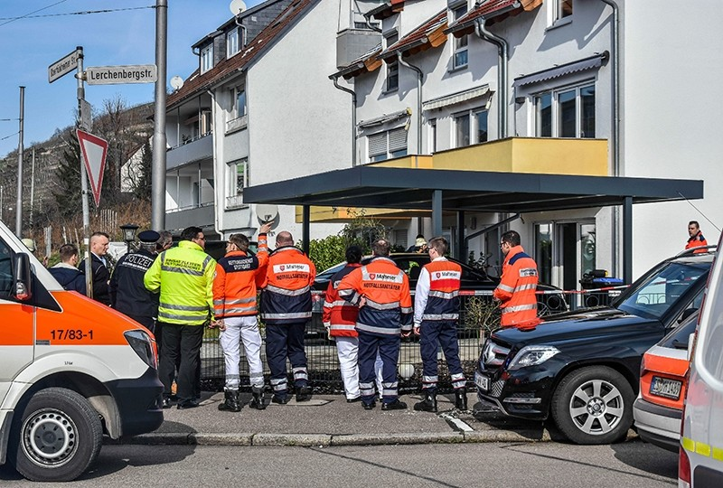 Rescue workers stand outside a house in Esslingen near Stuttgart, southern Germany, Monday, Feb. 5, 2018 after four people were found dead there along with indications of elevated carbon monoxide levels in the building. (AP Photo)