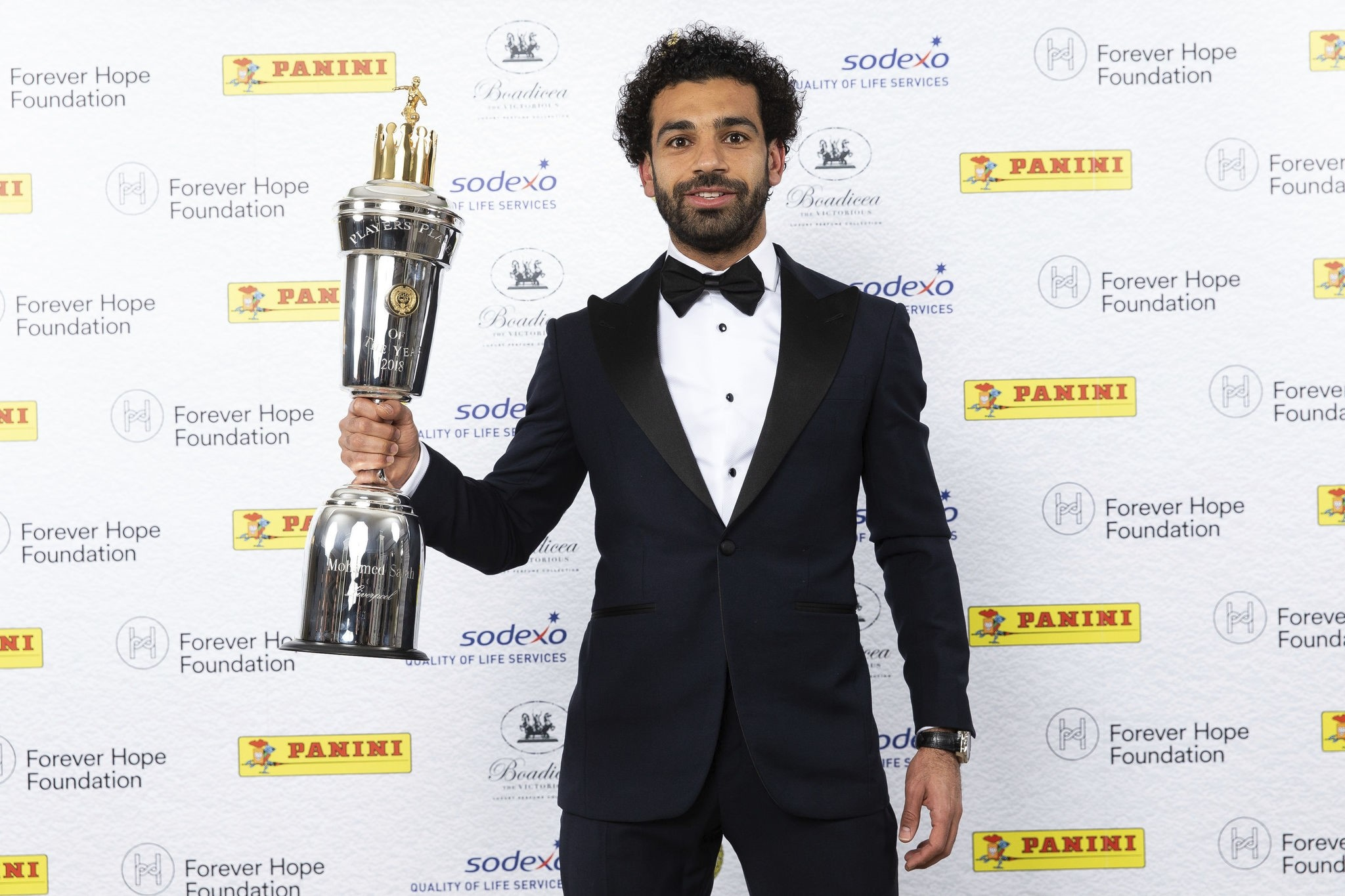 Mohamed Salah poses with the PFA Player Of The Year Award Trophy during the 2018 PFA Awards at the Grosvenor House Hotel, London, Sunday April 22, 2018. (AP Photo)