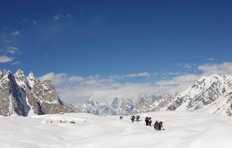 Trekkers and porters hike down the Baltoro glacier in the Karakoram mountain range in Pakistan, Sept. 7, 2014. (Reuters Photo)