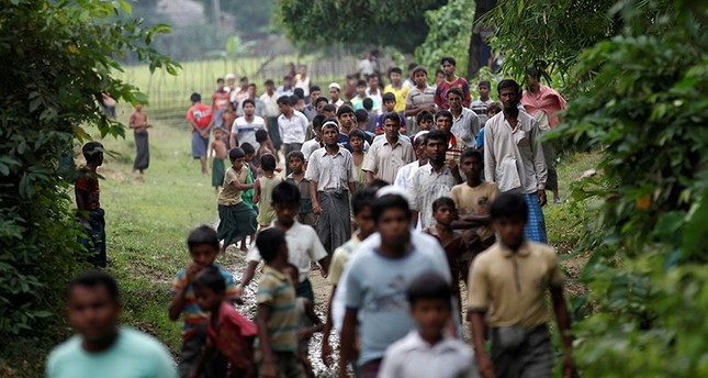 Men walk at a Rohingya village outside Maugndaw in Rakhine state, Myanmar October 27, 2016. (Reuters Photo)