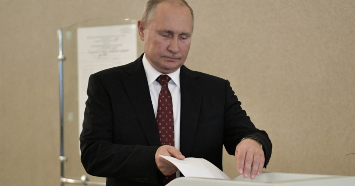Russia's President Vladimir Putin casts his ballot at a polling station during the Moscow city parliament election in Moscow, Russia September 8, 2019. (Reuters Photo)