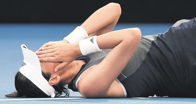 Muguruza fell to the ground behind the baseline and had treatment on her legs before retiring from her opening match against Aleksandra Krunic while leading in the third set.