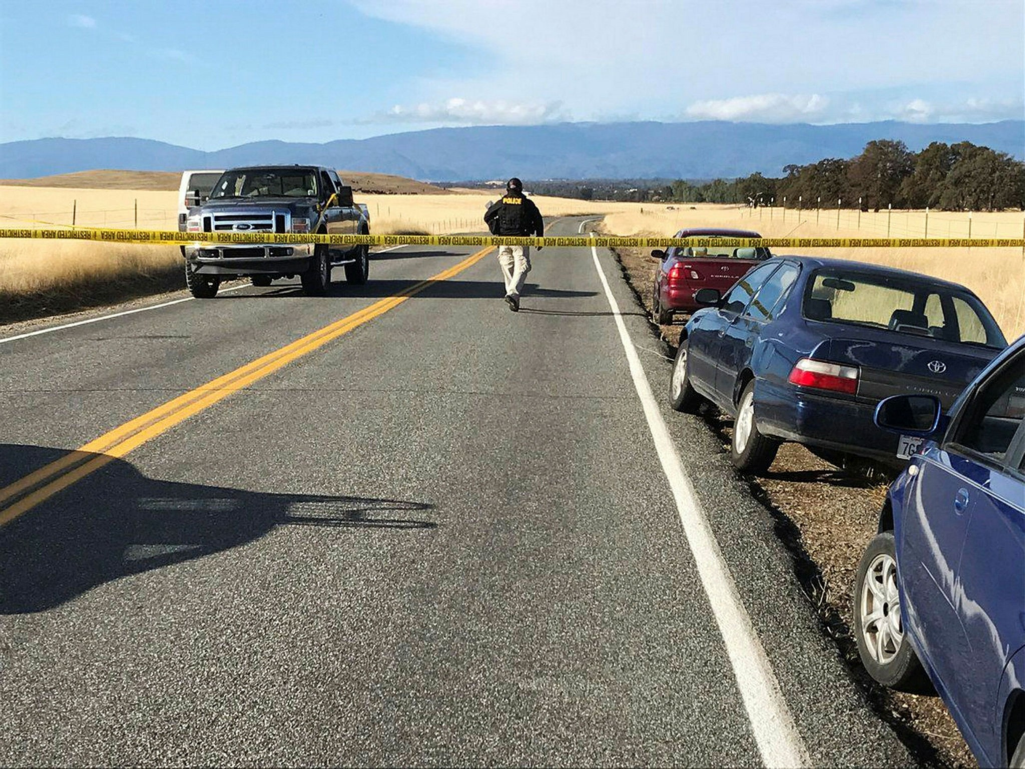 Crime tape blocks off Rancho Tehama Road in California, following a fatal shooting on Tuesday, Nov. 14, 2017. (AP Photo)