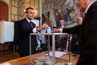 Polls predict Macron majority in parliament as France heads to polls