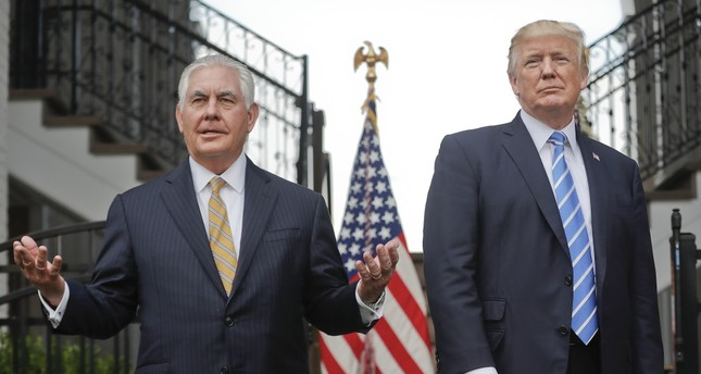 Secretary of State Rex Tillerson, left, speaks following a meeting with President Donald Trump at the Trump National Golf Club in Bedminster, Aug. 11.