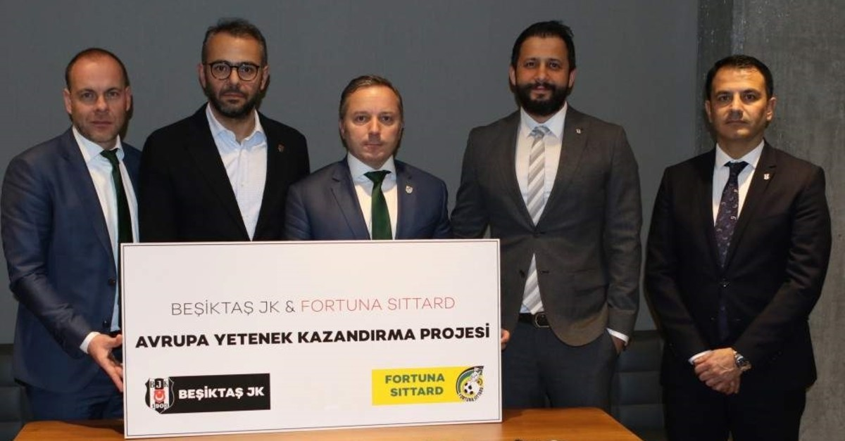 Beu015fiktau015f and Fortuna Sittard officials pose after the signing in Istanbul, Jan. 9, 2020. (AA Photo)
