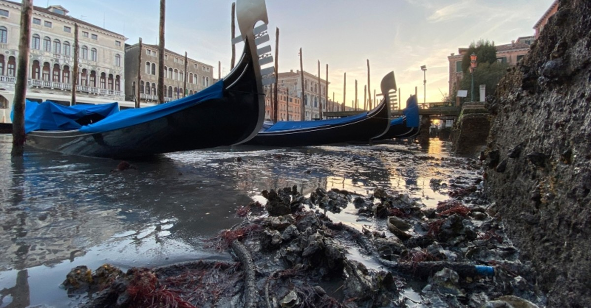 Gondolas are stranded in Venice, northern Italy, during exceptionally low tide, Thursday, Jan. 9, 2020. (AP Photo)