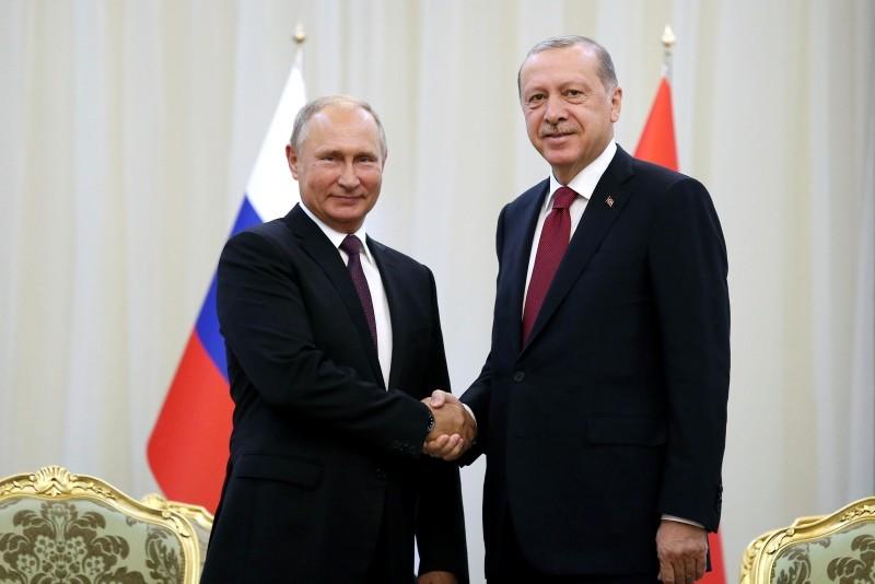 Turkey's President Recep Tayyip Erdou011fan right, shakes hands with Russia's President Vladimir Putin, in Tehran, Iran, Friday, prior to their talks, part of Russia-Iran-Turkey summit to discuss Syria, Friday, Sept. 7, 2018. (AP Photo)