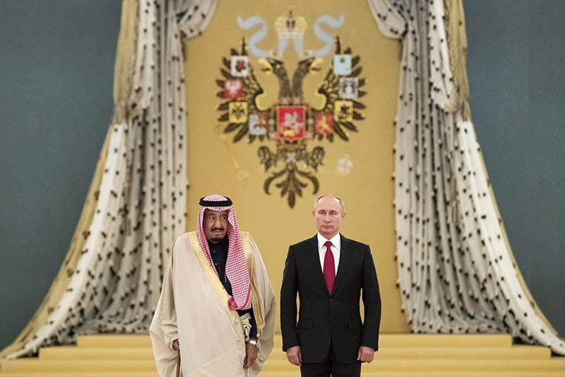 Russian President Vladimir Putin, right, and Saudi King Salman listen to national anthems during their meeting in Kremlin, Moscow, Russia, Thursday, Oct. 5, 2017 (AP Photo)