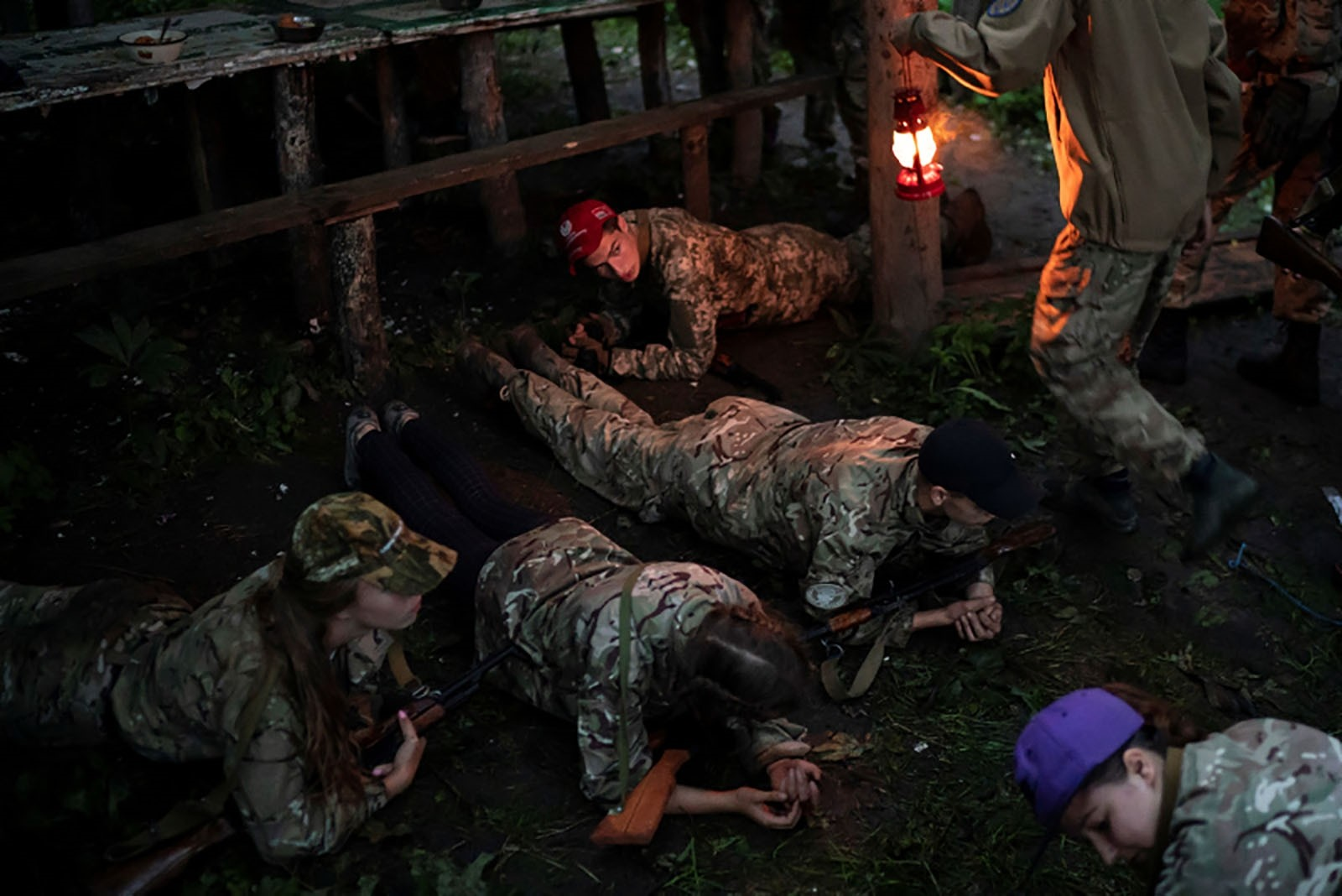 Participants hold a plank position before having dinner.