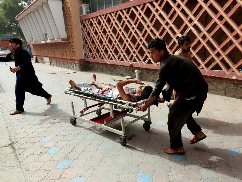 An injured man is pushed on a stretcher to a hospital after a car bomb in Jalalabad city, Afghanistan June 17, 2018. (REUTERS Photo)
