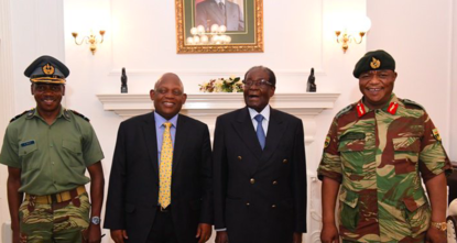 pZimbabwe President Robert Mugabe was shown meeting Thursday with the army commander who put him under house arrest, as negotiations with a South African delegation and a Catholic priest at the...
