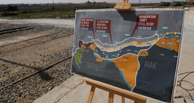A map showing Turkey's suggested possible operation in Syria, used by a TV journalist is seen at the border between Turkey and Syria, in Akcakale, Şanlıurfa province, southeastern Turkey, Tuesday, Oct. 8, 2019 (AP Photo)