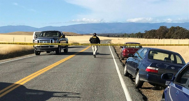 Crime tape blocks off Rancho Tehama Road in California, following a fatal shooting on Tuesday, Nov. 14, 2017. (AP Photo)