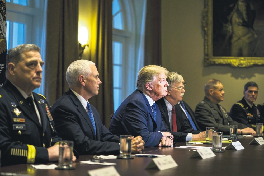 U.S. President Donald Trump (C) speaks with the media before a meeting with his military leadership in the Cabinet Room of the White House, Washington, April 8.