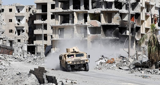 An armored vehicle of the Syrian Democratic Forces, provided by the U.S., is seen along a road in Raqqa, Syria October 8, 2017. (Reuters Photo)