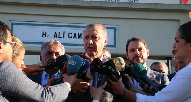 President Recep Tayyip Erdoğan speaks to reporters after prayers for the Qurban Bayram in Istanbul, Turkey September 1, 2017. (Presidential Photo Service via AA)